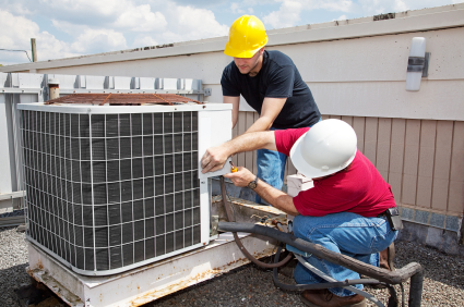 Airco Home Comfort Services - HVAC Contractors Working on a Roof Unit